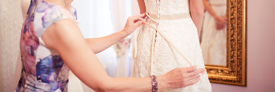 Dress fitting in a bridal shop
