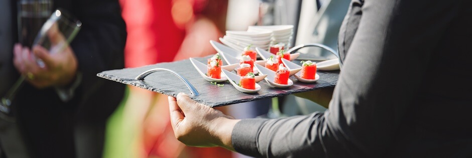 Caterer serving at a wedding